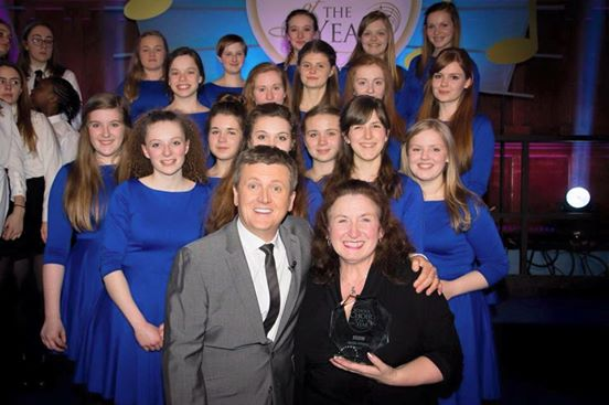 Hereford's Cantabile Girls Choir accepting the trophy from Aled Jones